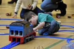 Children playing with giant Thomas tunnel